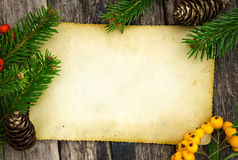 Christmas paper on wooden planks Stock Photography