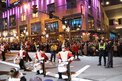 Christmas Parade. Group of Drummers performs on the street during Christmas Parade Stock Photo