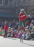 Christmas Parade Juggler on a Unicycle Stock Photo