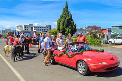 Christmas parade in Rotorua, New Zealand. Beauty queens in a car and children on horseback royalty free stock image
