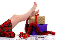 Christmas Parcels. Young female in tartan skirt with christmas parcels Royalty Free Stock Photo