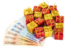 Christmas parcels with euro Stock Images