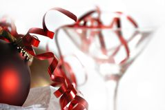 Christmas party. Ornament and martini glass stock image