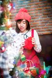 Christmas party. Asian lady with red dress on Christmas party Stock Photo