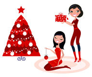 Christmas Party: beautiful women preparing Royalty Free Stock Images