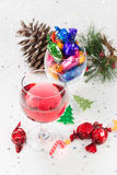 Christmas party celebrations with wine and wrapped chocolate swe Royalty Free Stock Photo