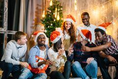 Christmas party friends at having drink and fun royalty free stock images