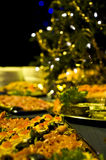 Christmas party food and tree Stock Image