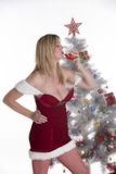 Christmas party goer with drink in hand Royalty Free Stock Photos