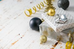 Christmas party invitation - silver, gold and black decorations. Top view Stock Photo