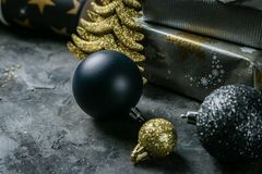 Christmas party invitation - silver, gold and black decorations. Top view royalty free stock photography