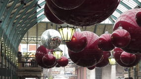 Christmas party ornaments and lights in Covent Garden stock footage