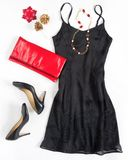 Christmas party outfi. Cocktail dress outfit, night out look on white background. Little black dress, red evening clutch , black s. Hoes, red ang gold necklace Royalty Free Stock Image