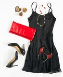 Christmas party outfit. Cocktail dress outfit, night out look on white background. Little black dress, red clutch , black shoes, r. Ed ang gold necklace and Stock Photo