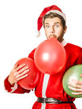 Christmas party planner blowing up balloons Stock Image