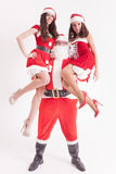 Christmas party 2016. Strong Santa holding a hot girls Stock Photos