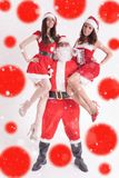 Christmas party 2016. Strong Santa holding a hot girls. Strong Santa holding a hot girls at the hands. Santa girlfriend. Sexy babes. Christmas party 2016 Stock Photography
