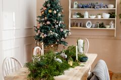 Christmas party table with branches of eve Stock Photography