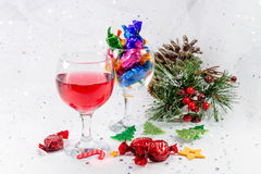 Christmas party table decorations with wine and chocolate sweets Stock Photos