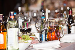 Christmas party table. In the restaurant with beverages and beautiful Bokeh Royalty Free Stock Photo