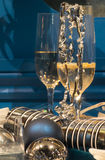 Christmas Party Table. Two Glasses of Champagne with Christmas Cracker and Baubles Stock Images