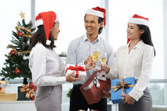 Christmas party. Vietnamese business people having Christmas party in the office Royalty Free Stock Photos