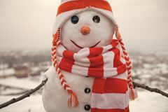 Christmas party, winter. Happy holiday and celebration. New year snowman from snow in hat. Snowman in winter outdoor. Xmas or christmas decoration stock image