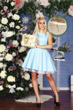 Christmas party, winter holidays blonde woman with gift box Stock Image