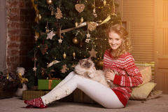 Christmas party, winter holidays woman with cat. New year girl. Royalty Free Stock Photography