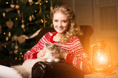 Christmas party, winter holidays woman with cat. New year girl. Royalty Free Stock Image