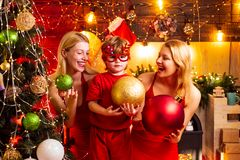 Christmas party. Women red dresses celebrate christmas with little cute baby. Family bonds. Love peace joy. Kid boy with. Mom or aunts sisters having fun. Join stock photos