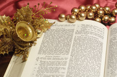 Christmas passage. Bible open to the Christmas passage of Luke 2 with gold decor Royalty Free Stock Images