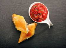 Christmas pasties with a spicy dip on a stone board Stock Photography