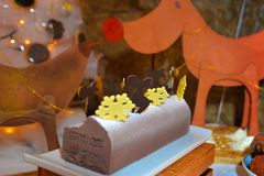 Christmas Pastry Decorations, Seasoned Chocolate Reindeer and Ice Flakes Stock Image