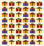 Christmas pattern. With boxes, ribbon and green sprays Royalty Free Stock Image