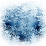 Christmas pattern. Frosty christmas pattern at a winter window glass Royalty Free Stock Photo