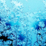 Christmas pattern. Frosty christmas pattern at a winter window glass Royalty Free Stock Images