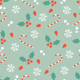 Christmas pattern with candy canes and hollies Royalty Free Stock Image