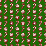 Christmas pattern with candy canes. Vector seamless background. Merry Christmas! Red and white candy canes on green background. Seamless pattern. Vector Royalty Free Stock Photo