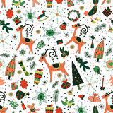 Christmas pattern with deers and trees. Winter forest with snowflakes. Seamless pattern for holidays Royalty Free Stock Images