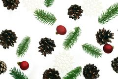 Christmas pattern fir brunches and pine cones on the white backg Royalty Free Stock Image