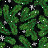 Christmas pattern with fir paws and snowflakes Royalty Free Stock Photography