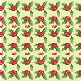 Christmas pattern of Holly leaves and berries. Royalty Free Stock Photography