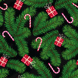 Christmas pattern made of fir branches, gifts and candies Royalty Free Stock Photo