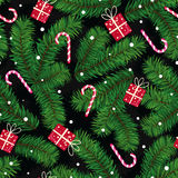 Christmas pattern made of fir branches, gifts and candies Royalty Free Stock Image
