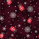 Christmas pattern made of fir branches, gifts and snowflakes Royalty Free Stock Image