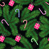 Christmas pattern made of fir limbs, gifts and candies Royalty Free Stock Photography