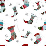 Seamless pattern with colorful socks on a white background. stock illustration