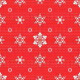 Christmas pattern with openwork snowflakes. Christmas mesh lace seamless pattern with openwork snowflakes on red background Royalty Free Stock Photos