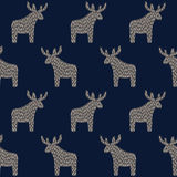 Christmas pattern with reindeer on dark blue background. Simple seamless Happy New Year background. Winter holidays vector design for textile, wallpaper, web Royalty Free Stock Images